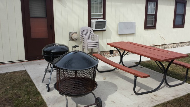Grill and fire pit at Cozy Corner Cottages cabins