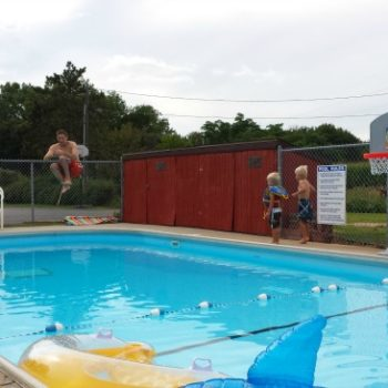 In-ground swimming pool at Cozy Corner Cottages